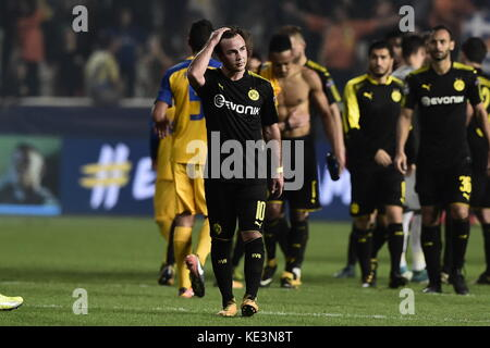 Nicosia, Cyprus. 17th Oct, 2017. Dortmund's players, a.o. Mario Goetze (C), leave the field after the 1-1 draw at - Stock Photo