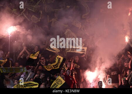 Nicosia, Cyprus. 17th Oct, 2017. Dortmund's fans hold up flares during the Champions League group stages qualification - Stock Photo