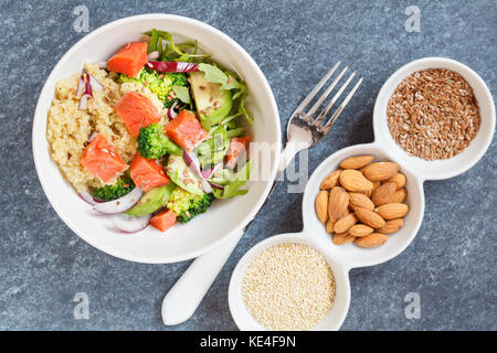 Healthy salad with broccoli, fish and quinoa. top view, dark background. - Stock Photo