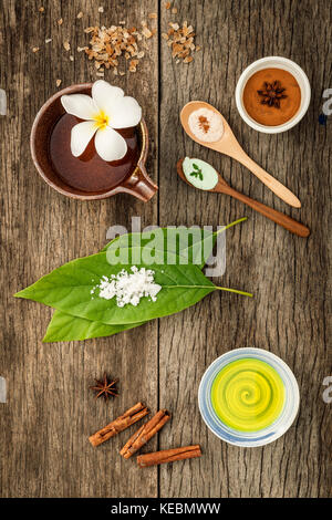 Avocados  leaves with nature spa ingredients dried indian bael ,cinnamon powder ,cinnamon sticks ,aromatic oil ,star - Stock Photo