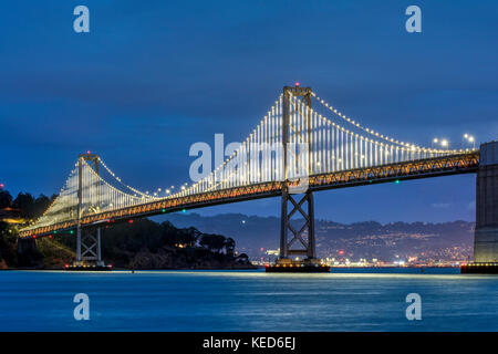 Night view of the the western section of the San Francisco-Oakland Bay Bridge, San Francisco, California, USA - Stock Photo