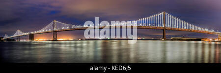 Panoramic night view of the the western section of the San Francisco-Oakland Bay Bridge, San Francisco, California, - Stock Photo