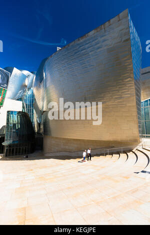 Visitors at Architect Frank Gehry's Guggenheim Museum in titanium and glass at Bilbao, Basque country, Spain - Stock Photo