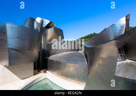 Architect Frank Gehry's Guggenheim Museum futuristic architectural design in titanium and glass at Bilbao, Basque - Stock Photo