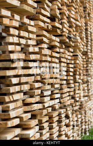Beech planks stacked for seasoning at logging timber plant in Valle del Roncal in Pyrenees, Northern Spain - Stock Photo