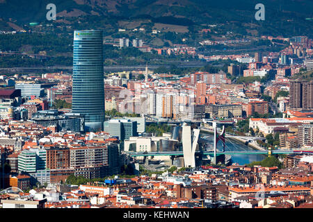 Aerial view of Bilbao Guggenheim Museum, Iberdrola Tower skyscraper and Red Bridge in Basque country, Spain - Stock Photo