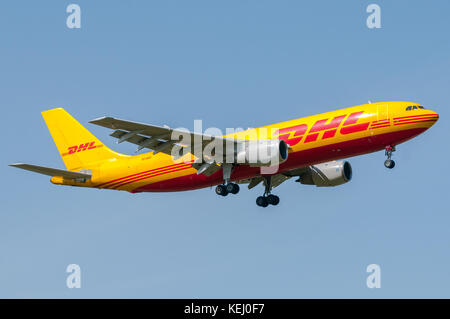 London, UK, April 9th 2011: an aircraft of international freight DHL in short final for landing at Heathrow. - Stock Photo