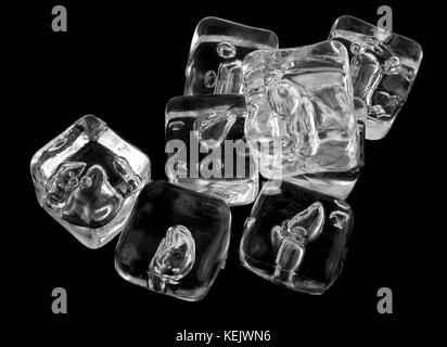 Ice cubes on a black background. - Stock Photo