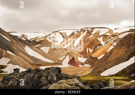 Landmannalaugar/Landmannalaugavegur colourful mountains still covered with snow, beginning of Summer, hiking trail - Stock Photo