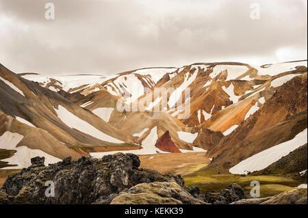 Landmannalaugar/Landmannalaugavegur colourful mountains still covered with snow, beginning of Summer, hiking trail - Stock Photo