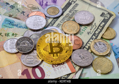 Golden bitcoin euro background bitcoin cryptocurrency stock photo bitcoin with world currencies including chinese yuan dollar euro pound stock photo ccuart Image collections