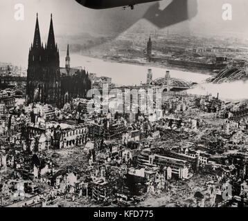 The Cologne cathedral stands tall amidst the ruins of the city after Allied bombings, 1944.  World War II - Stock Photo