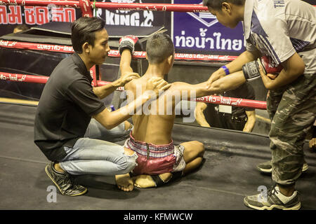 Massage, Boy, Muay Thai boxer before the fight starts, Bangkok, Thailand - Stock Photo