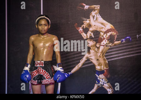Boy, Muay Thai boxer before the fight starts, Bangkok, Thailand - Stock Photo