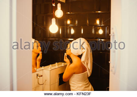 Young women doing her evening makeup routine - Stock Photo