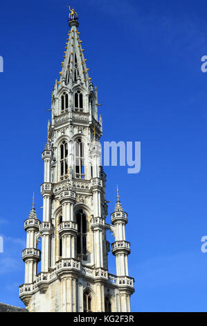 The Brabantine Gothic architecture of belfry tower of City of Brussels Town Hall at Grand Place in Brussels, Belgium - Stock Photo