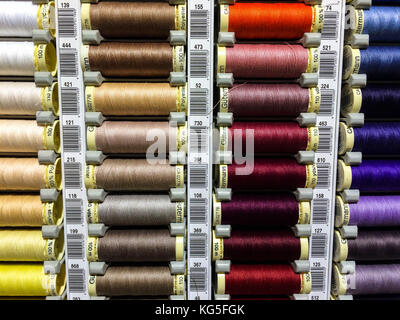 Coloured cotton reels for sewing machines, close-up - Stock Photo
