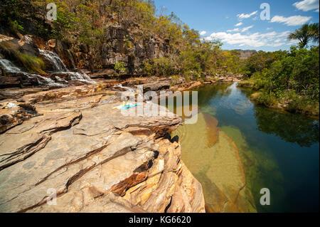Tourist at Almecegas II waterfall with little water because of drough time, Chapada dos Veadeiros, Goias, Brazil - Stock Photo