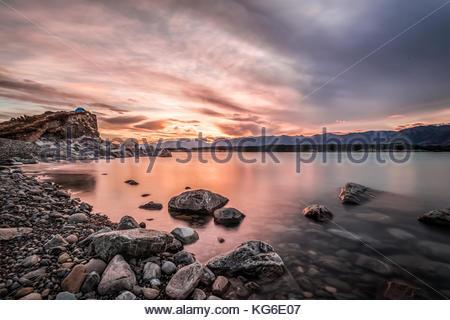 Sunset at Mount Cook National Park alongside Lake Pukaki - Stock Photo