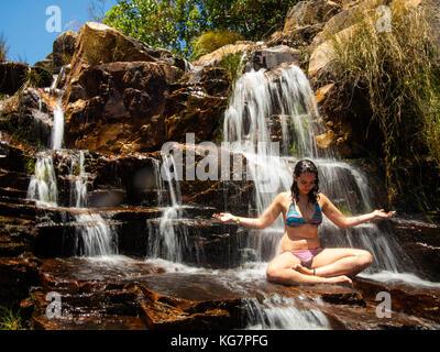 Tourist bathing at Almecegas II Waterfall, Chapada dos Veadeiros, Goias, Brazil - Stock Photo
