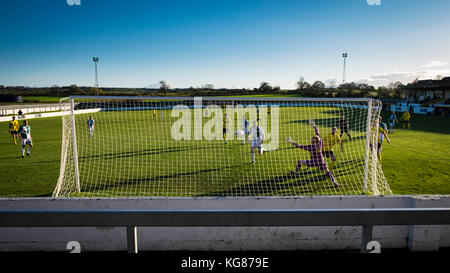 West Auckland, County Durham, UK. 4th November, 2017.  West Auckland's Paul Connor strokes home his team's first - Stock Photo