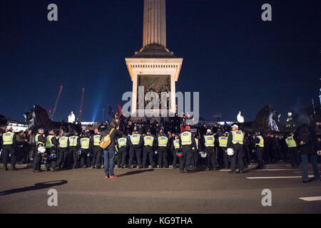 London, United Kingdom. 05th Nov, 2017. Million Mask March 2017 takes place in central London. Police form a cordon - Stock Photo
