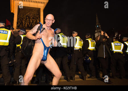 London, United Kingdom. 05th Nov, 2017. Million Mask March 2017 takes place in central London. A protester in a - Stock Photo