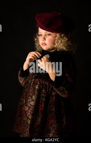 Attractive girl in brown old-fashioned costume - Stock Photo