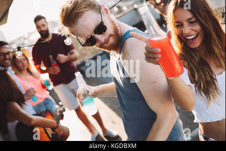 Happy couple having fun time at party - Stock Photo