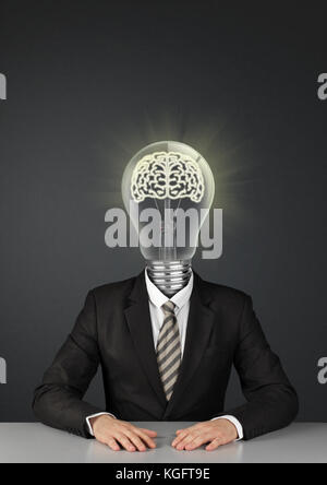 Businessman on black with light bulb instead of head, great ideas concept - Stock Photo