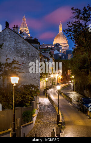 Roadway leading up hill through Montmartre towards Basilique du Sacre Coeur, Paris France - Stock Photo