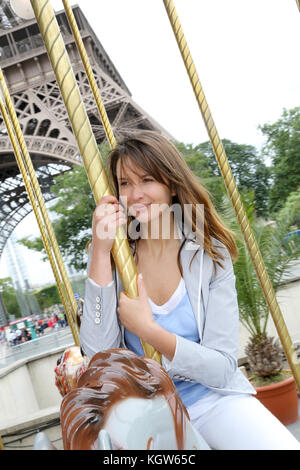 http://n450v.alamy.com/450v/kgw65c/beautiful-woman-sitting-on-a-carousel-in-paris-kgw65c.jpg