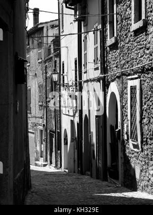 Typical italian small alley in a small town - Stock Photo