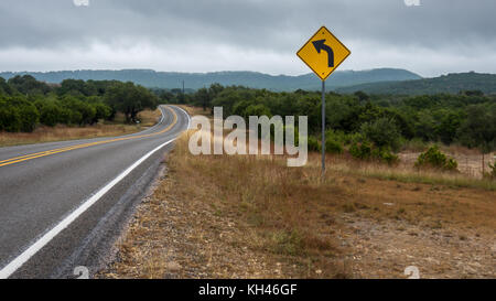 Traffic Sign On the Side of Road in the Hill Country - Stock Photo