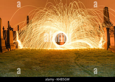 light painting graves with steel wool - Stock Photo