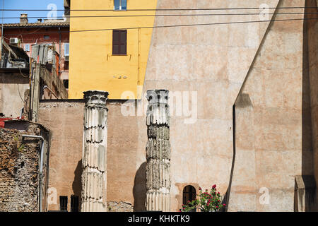 Old columns on the square of Argentina against the background of residential buildings, Rome Italy - Stock Photo