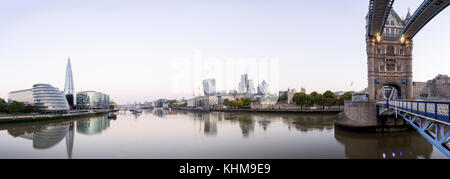 UK, London, Tower Bridge and the city skyline across Thames River with view of the Shard and the financial district - Stock Photo