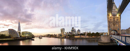 UK, London, Tower Bridge and the city skyline across Thames River with view of the Shard and the financial district, - Stock Photo