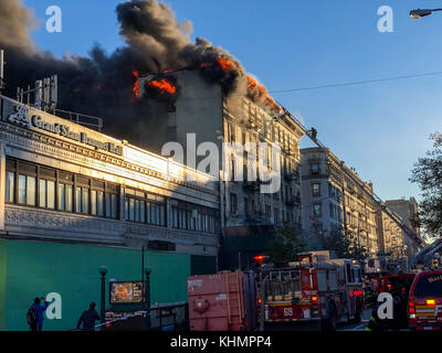 New York, United States. 17th Nov, 2017. A major fire is seen in a building at the intersection of 144th Street - Stock Photo