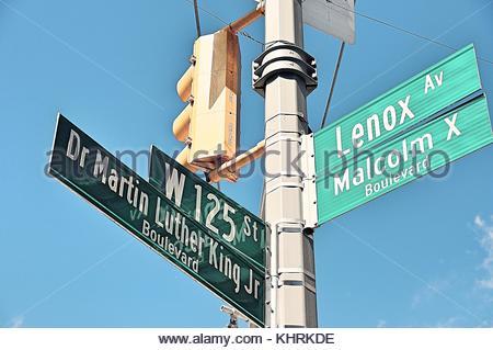 Crossroad between 125th Street-Martin Luther King Boulevard/Lenox Avenue-Malcolm X Boulevard in Harlem, New York, - Stock Photo