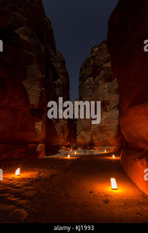Petra By Night. Narrow gorge of the Siq - Stock Photo