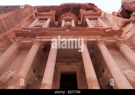 Al Khazneh in Petra, Jordan. Al Khazneh was carved out of a sandstone rock face. It has classical Greek-influenced - Stock Photo