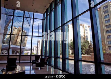 Building glass . window view of the building . Empty office room on modern building with sunlight - Stock Photo