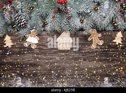 Christmas fir tree with decoration on dark wooden background - Stock Photo
