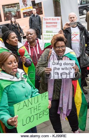 London, UK. 22nd Nov, 2017. Women hold sign-boards outside Zimbabwe House on The Strand in London, United Kingdom - Stock Photo