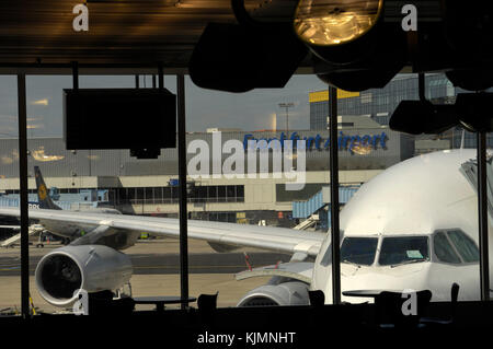 windshield of the South African Airways Airbus A340 parked at a gate and Lufthansa Boeing 737 parked behind at the - Stock Photo