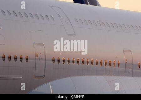 doors and windows of the Airbus A380-800 parked in the static-display at the 2006 Farnborough International Airshow - Stock Photo