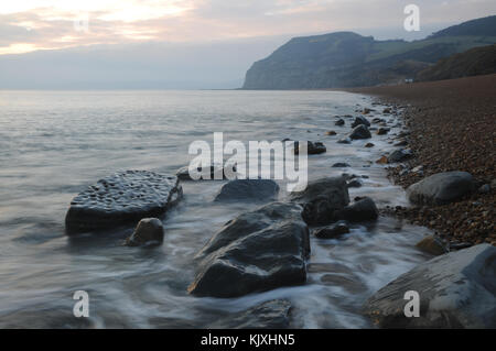 Evening light on fossil rich Jurassic coast beach - Stock Photo