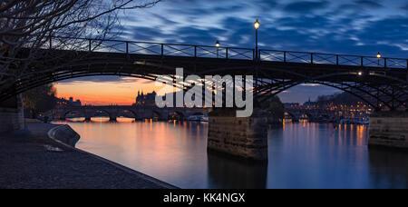 Sunrise on the Seine River with Pont des Arts and Pont Neuf. Ile de la Cite, 1st Arrondissement, Paris, France - Stock Photo