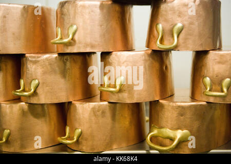 Paris/France. Restaurant Brasserie La Coupole. Copper pans in the kitchen - Stock Photo